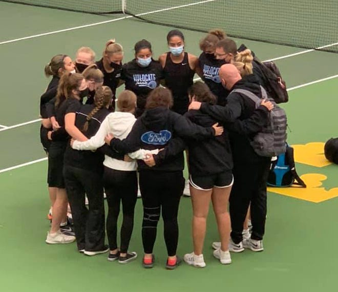 The River Valley Wildcats huddles for a pep talk before playing in the bubble at Gustavus for their second round Section playoff game on Oct. 7.