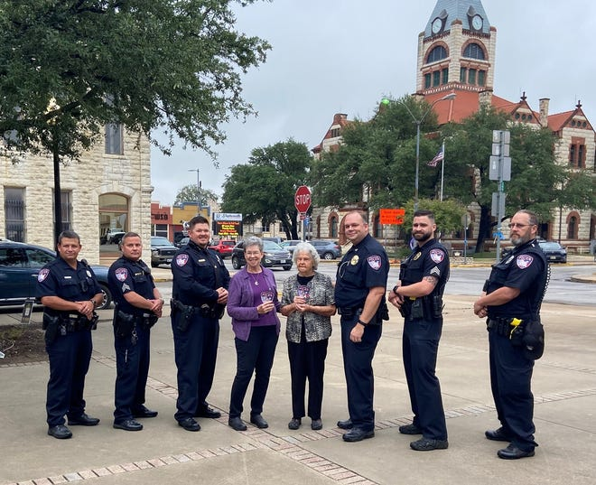 As part of Breast Cancer awareness month during October, the Stephenville Police Department has issued pink uniform patches. They have also invited survivors to receive a pink SPD patch in honor of their victory over the disease. The first two recipients are Renee Gresham and Mabel Trotter, center, Capt. Gresham's mother and grandmother.