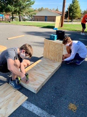 Volunteers build dog houses at the 2020 Doghouse Derby.