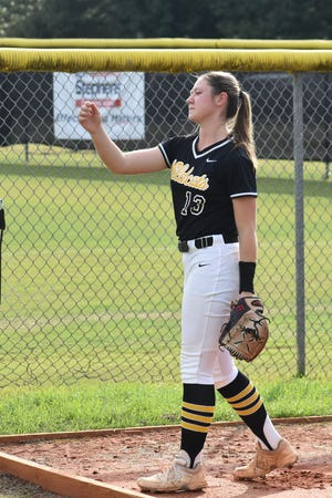 Richmond Hill High School pitcher Katie Rearley loosens up in the bullpen before a game.