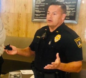 Topeka police Lt. Manuel Munoz gestured with his hands Monday while speaking during a news conference in the front lobby at City Hall.