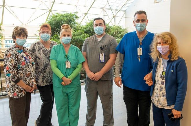 Nurses Terry Gentile, Sheila King, Pam George, John Brierley, Cederic Avola and Brenda Valery work at St. Vincent Hospital.