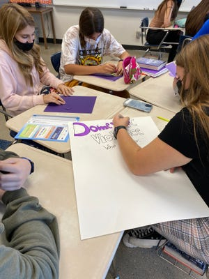 MHS students in Crystal Goins' English class make posters to raise awareness about domestic violence. The class is taking a project-based learning approach to start a community conversation about intimate partner violence.