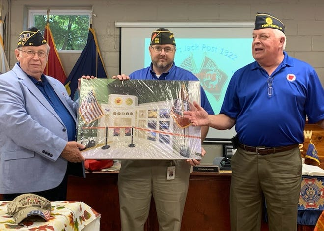 Arkansas Military Veterans Hall of Fame board members Keith Greene (left) and Roger Rickard (right) presented Robert Jack VFW Post 1322 Commander Matthew Hicks a framed canvas photo of the AMVHOF display that can be seen in the treasurer's office at the Arkansas State Capitol.  Post 1322 is a First 100 Supporter of the Hall of Fame.