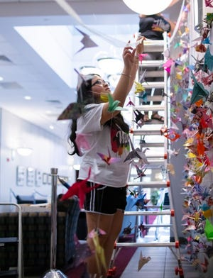 More that 2,000 paper cranes  symbolizing solidarity against acts of hatred toward Asian Americans, Pacific Islanders, and other marginalized groups are on display at the University of Arkansas at Fort Smith.