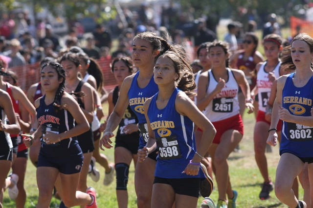 Serrano's Xyrie Goeson, center, leads a pack of runners at the Fleet Feet Inland Empire Challenge at Glen Helen Regional Park on Oct. 9, 2021.