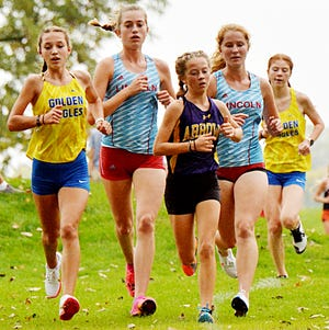 Seventh-grader Kate McElroy (center) finished fourth and led Watertown High School's girls cross country team to a fourth-place finish in the Eastern South Dakota Conference meet over the weekend. McElroy and teammate Victoria Smith, who finished sixth, each earned All-ESD honors and lead the Public Opinion's weekly list of top area high school performers.
