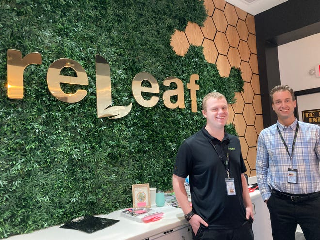 Staff member Connor Trudell, left, and general manager Luke Hunsberger welcome customers to ReLeaf Alternative.