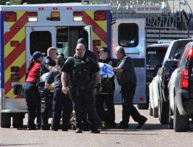 A male shooting victim is wheeled from a home in the 4000 block of Redbud Circle about 3 p.m. Monday. He was taken by ambulance to the northside Hendrick Medical Center.