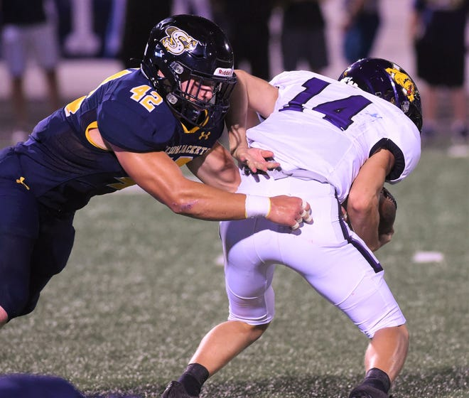 Stephenville linebacker Reese Young (42) wraps up Wylie quarterback Aden Kincaid (14) earlier this season. Against Waco La Vega, Young had 25 tackles, 15 solo as the defense held the Pirates to 94 yards on 44 rushes. For his efforts, Young was named the Big Country Player of the Week.