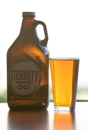 Genoa Township's Eternity Brewing is one of several local brewers participating in the Growl-er Brewfest this weekend. The brewer's local ale and growler are shown Monday, Oct. 11, 2021.