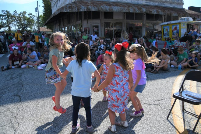 A group of children dance Friday afternoon during the 75th annual Turkey Trot festival in Yellville.