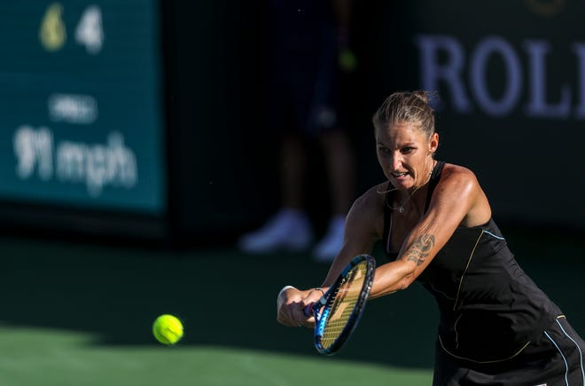 Karolina Pliskova of Czechia returns the ball to Beatriz Haddad Maia of Brazil during their round three match of the BNP Paribas Open, Monday, Oct. 11, 2021, in Indian Wells, Calif.