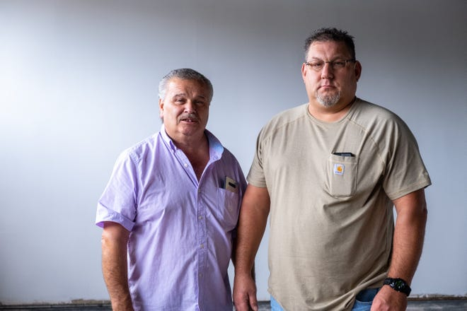 Mike Duenaz and his son Joe Duenaz pose for a portrait Friday, Oct. 8, 2021, in the future Duenaz family restaurant in Port Huron.