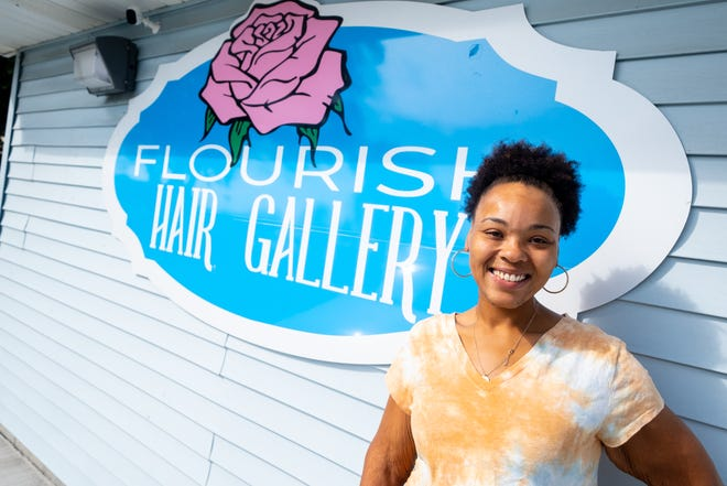Naesa Richardson, owner of Flourish Hair Gallery, poses for a portrait Monday, Oct. 11, 2021, outside the Port Huron salon. Richardson is opening another location on Port Huron's north end.