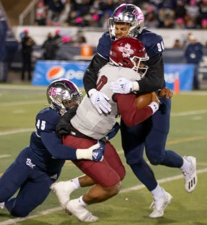 New Mexico State quarterback Jonah Johnson (10) was sacked six times by the Nevada defense on Saturday night.