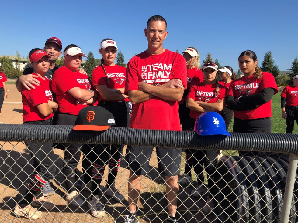 Former San Francisco Giants and Los Angeles Dodgers minor league player Petie Roach stands with his arms crossed in front of players and coaches he works with at Simpson University on Saturday, Oct. 10, 2021.