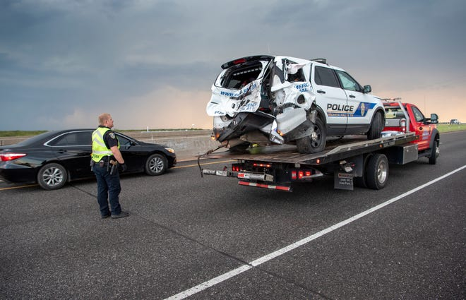 A Wichita Falls police officer was injured after a pickup truck ran into their patrol car on Central Freeway Sunday afternoon.