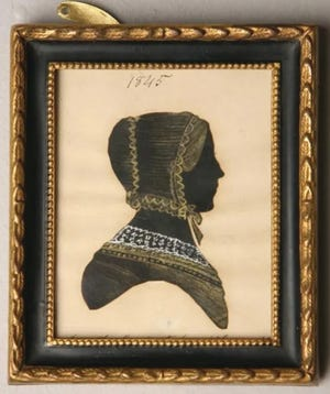 This silhouette of a woman, cut by mouth by Martha Ann Honeywell, had an estimated value of $400 to $800 at Garth's Auction, Inc., but did not sell.
