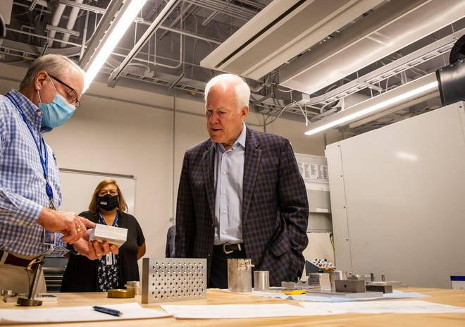 U.S. Sen. John Cornyn, R-Texas, right, gets a tour of Austin Community College's Impact Lab from Douglas Smith, chair of the architectural and engineering computer-aided design department, after a roundtable discussion focusing on Hispanic-serving institutions Tuesday at ACC's Highland campus.