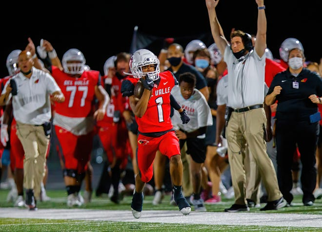 Del Valle's Lawrence Martin sprints for a touchdown against Westlake in a District 26-6A contest last month. Martin and the Cardinals picked up their first win of the season against Akins on Friday.