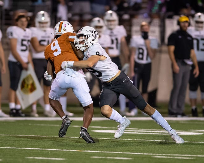 Vandegrift senior defensive back Jaxon Oliver, right, making a tackle against Westwood in 2020, had seven tackles, grabbed an interception and caused a fumble for the second week in a row during Vandegrift's 49-7 win over McNeil.