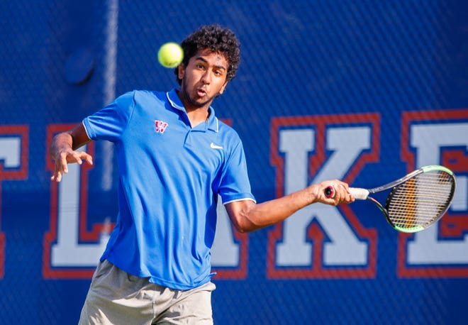 Westlake's Devan Sabapathy returns the ball against Lake Travis during boys doubles at a District 26-6A tennis match on Sept. 28. Lake Travis avenged that loss by beating Westlake in the finals of last week's District 26-6A tournament.