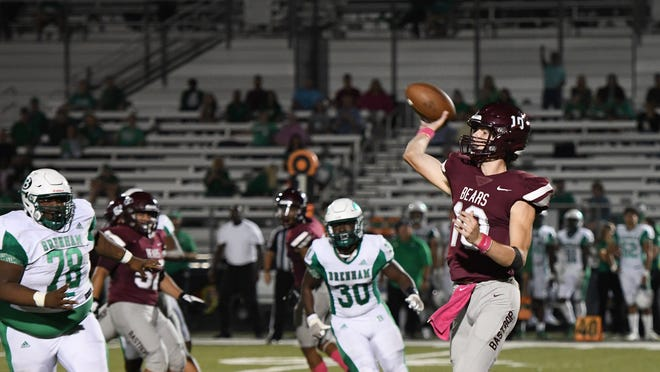 Bastrop's Seth Mouser airs out a pass against Glenn.