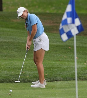 Hudson's DeLaney DiGeronimo putts on 17 during the Division I girls golf district tournament at Brookledge Golf Course Tuesday, Oct. 12, 2021 in Cuyahoga Falls, Ohio.