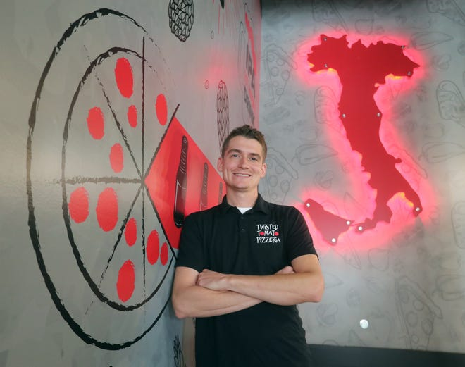 Twisted Tomato Pizzeria & Beer Wall owner Brad Cover is opening his new location this month in downtown Akron.