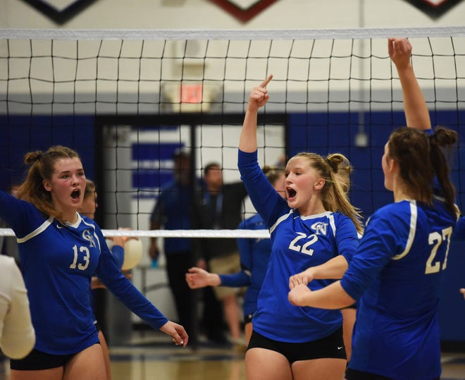 Colo-NESCO's Jenna Hill (13), Sophia Piziali (22) and Rylie Handsaker (27) celebrate a point during the Royals' five-set victory over Collins-Maxwell Oct. 7 at Colo.
