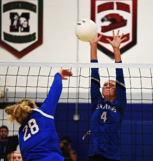 Collins-Maxwell's Chloe Wierson goes up for one of her seven blocks during the Spartans' five-set loss to Colo-NESCO Oct. 7 in Colo.