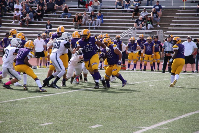 OLSH senior Dion McIntosh (No. 55) pulls to his left during an Oct. 2 matchup against the Rochester Rams at Moon Area High School.