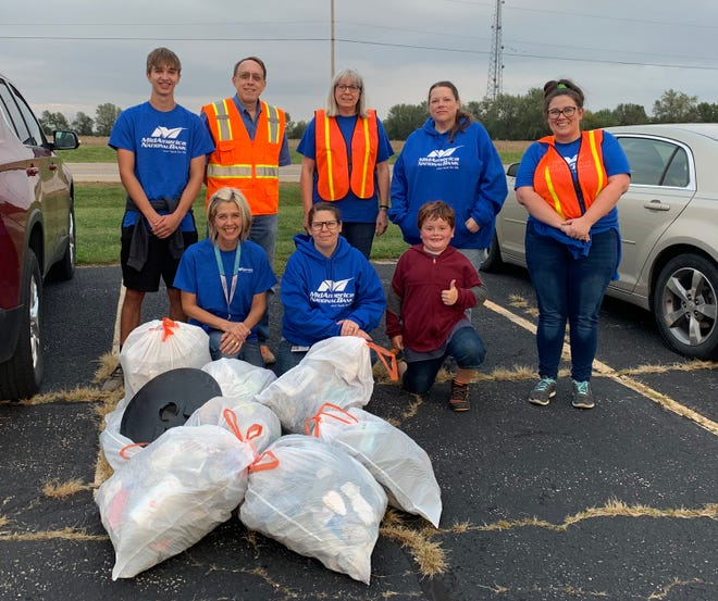Pictured are some of the MidAmerica National Bank employees and their family members. They recently joined together to help with Canton's Adopt-A-Street Program and picked up discarded litter.