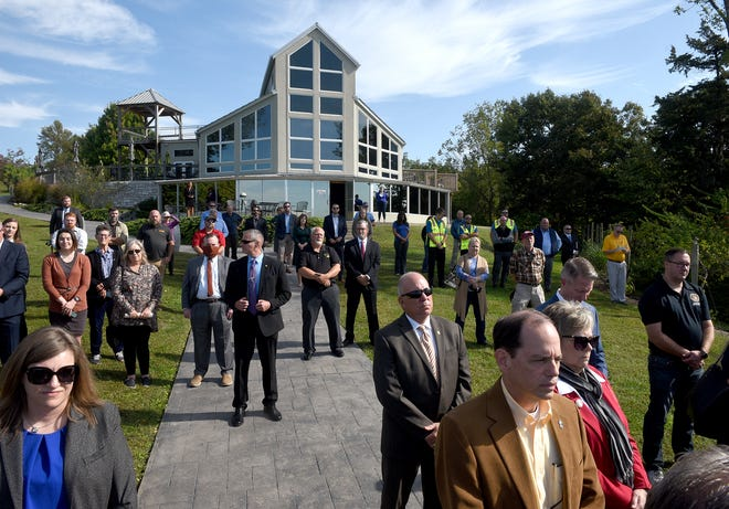 More than 100 people watch the Rocheport Bridge bolt-turning ceremony on Tuesday at Blufftop Bistro at Les Bourgeois Vineyards to celebrate the beginning of construction on the $240 million project.