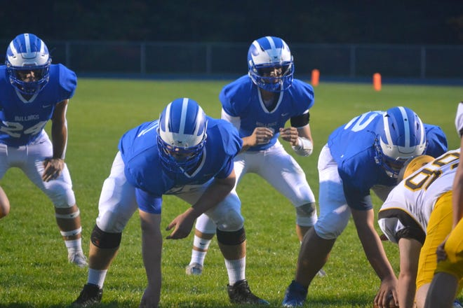 Inland Lakes quarterback Mason Blumke, running back Grant Blumke and offensive linemen get ready for an upcoming play during a recent contest against Pellston at home. Inland Lakes improved to 7-0 overall with a 49-6 victory over the Hornets.
