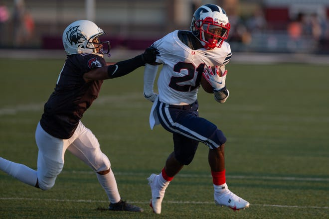 Running back Zyreek Brunner (21) and Eastmoor Academy improved to 4-3 overall and 3-0 in the City League-South Division with a 40-22 win over Columbus South on Oct. 9.