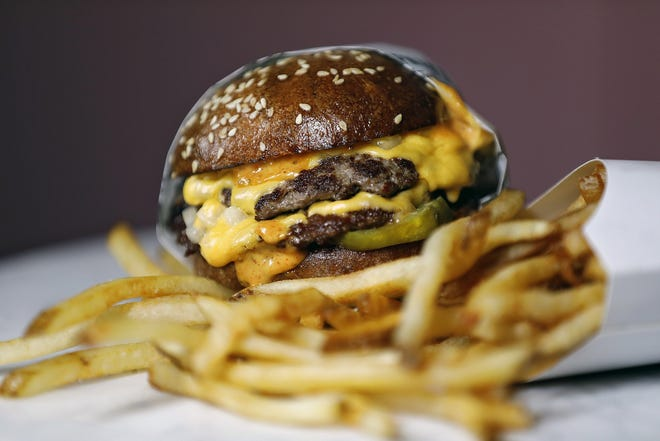 A Chapman's double burger and shoestring fries at Chapman's Eat Market in Columbus.