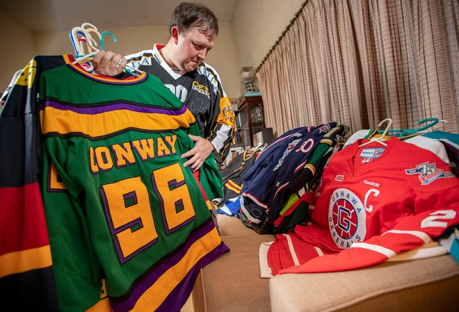 """Jason """"Jas"""" Chaffin, sifting through his massive hockey jersey collection, has run a Twitter account called @cbjprospectssince March 2010.The account chronicles each of the Columbus Blue Jackets' draft picks andhowthey're doing on their collegiate, minor league or international team."""