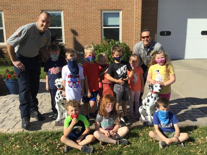 Firefighters Jim Perreault and Shane Heldstab are pictured with Cathedral School kindergartners