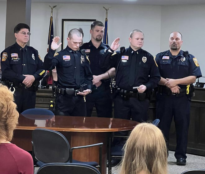 New Crookston police officers, Loren Edevold, pictured second from left, and James Brandon, second from right, were sworn in October 8. Other officers in the photo: Don Rasicot, Dave Grabowski and Darin Selzler