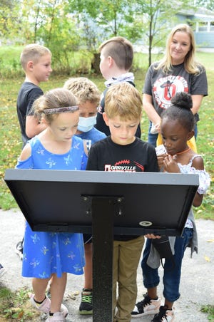 """Orrville Elementary School second grade students read aloud together """"Over in the Meadows"""" at the Storybook Trail."""
