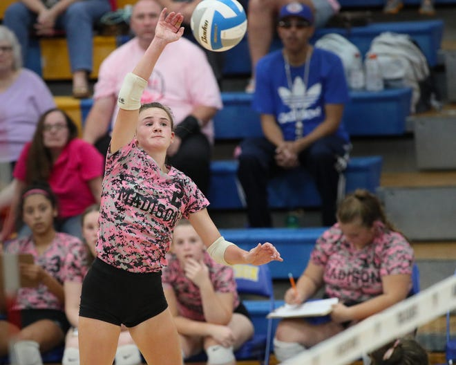 Madison's Abby Weber goes up for a kill during Monday's match against Whiteford. [Telegram photo by John Discher]