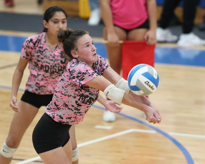 Madison's Abby Weber digs up a ball during Monday's match against Whiteford. [Telegram photo by John Discher]
