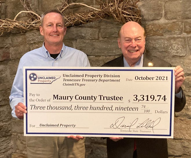 State Treasurer David H. Lillard, Jr. (right) presents  a check from the Tennessee Department of Treasury  for unclaimed property to Trustee Randy McNeece  (left) on behalf of Maury County Government