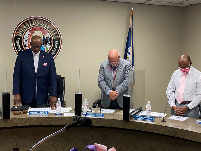Donaldsonville City Council members Charles Brown Sr., Raymond Aucoin, and Lauthaught Delaney Sr. stand at the beginning of the Oct. 12 meeting.