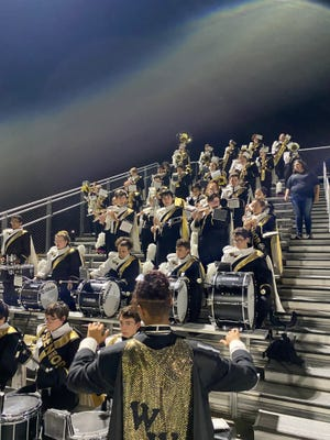 Pictured is Malinowski conducting the Western Wayne Band during their recent performance at a home football game that also served as their senior night. Malinowski's fellow drum major is junior Maggie Nagle.