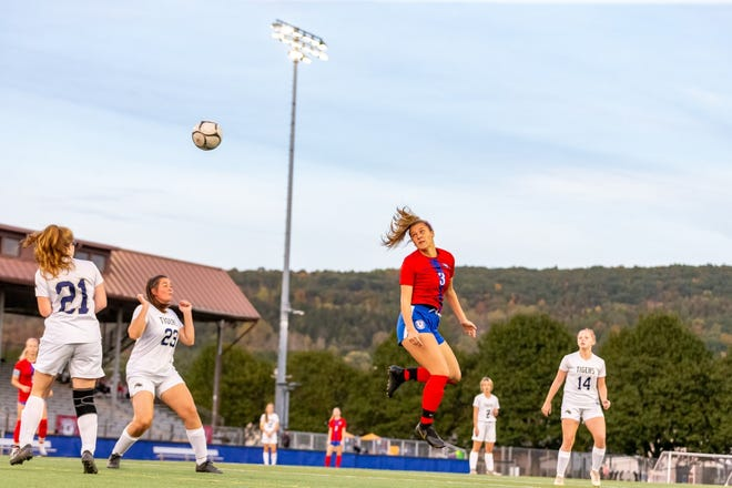 Hornell's Lilly Adams directs a header towards the net during Monday's win in Maple City Park.