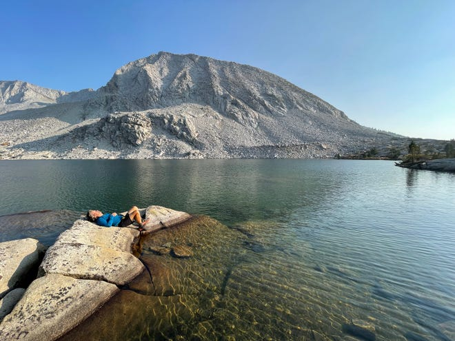 David DeLong relaxes at Bernice Lake during a backpacking trip with Times-Union columnist Mark Woods in Yosemite National Park.