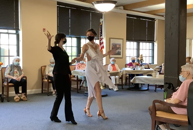 Two dancers from the Fred Astaire Dance Studio in West Springfield recently stopped by the Heywood Wakefield Commons to show the residents some of their moves. The two performers were Michelle Davy, in black, and Maia Seetal, in white.